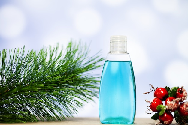 Christmas decoration and spa accessories on blue background