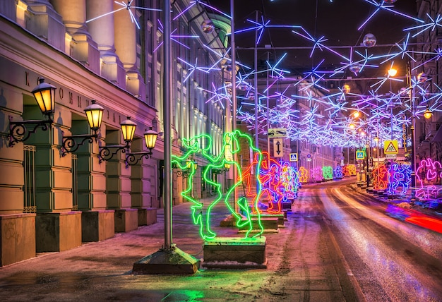 Christmas decoration of the street in moscow in the form of dancing people