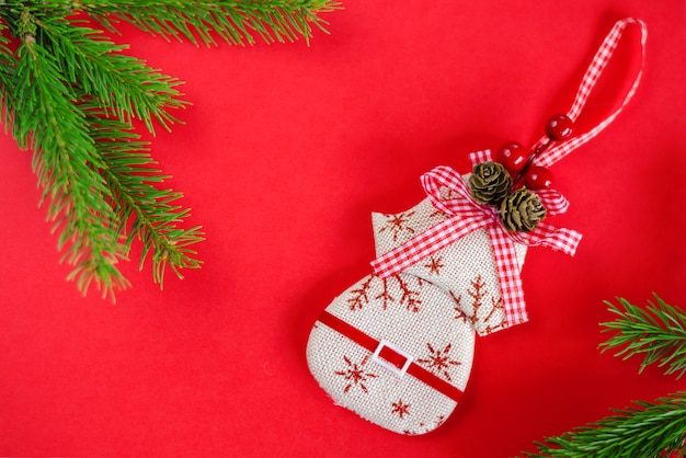 Christmas decoration toy on red . top view, flat lay, copyspace. greeting card