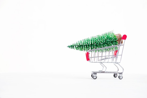 Christmas decoration tree on red shopping cart.