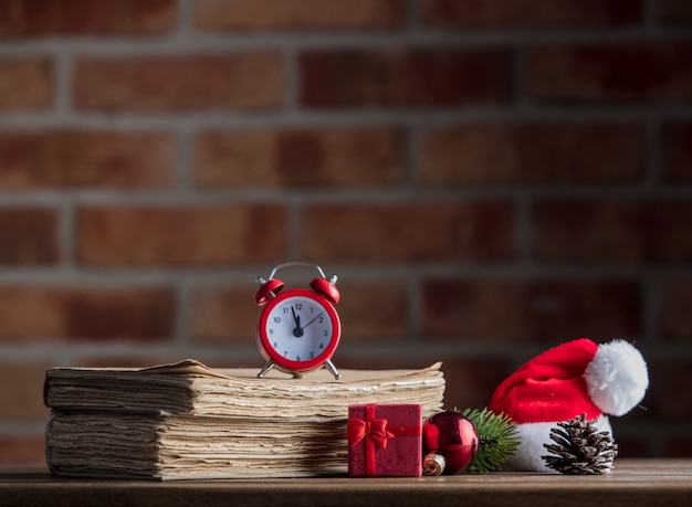 Christmas decoration with alarm clock and old books