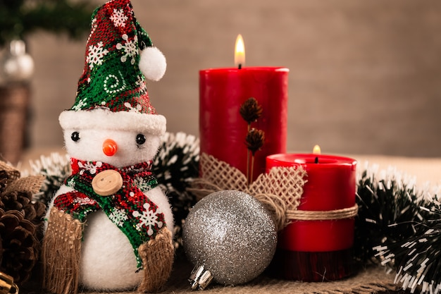 Christmas decoration with balls and candle.