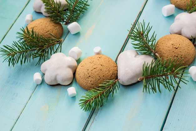Christmas decoration with fir tree, christmas cookies and marshmallow.