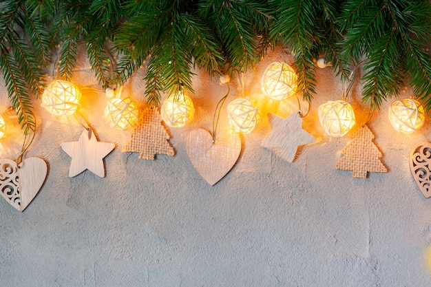Christmas decoration with garland lights on concrete background