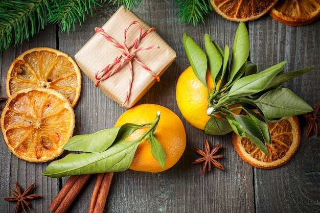 Christmas decoration with gift box and tangerines