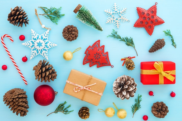 Christmas decoration with gift boxes and ornament on blue background.