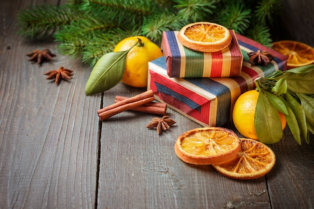Christmas decoration with gift boxes and tangerines