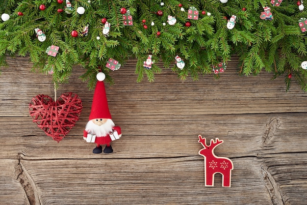 Christmas decoration with santa and heart on white wooden background. copy space, top view
