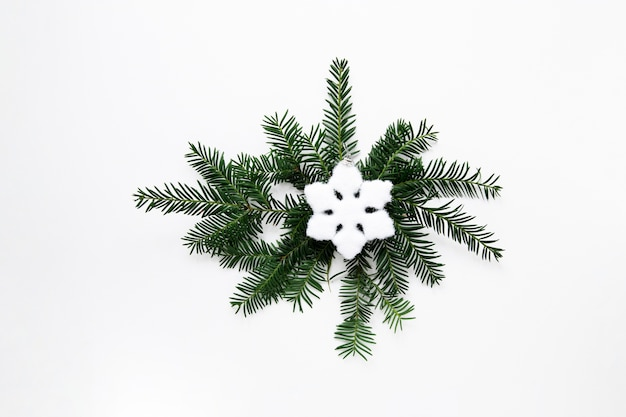 Christmas decoration with snowflake flat lay