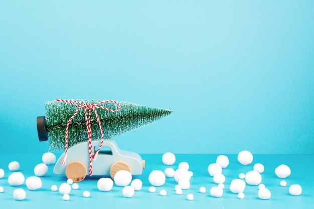 Christmas decoration with wooden car, pine tree, with copy space. season greeting card