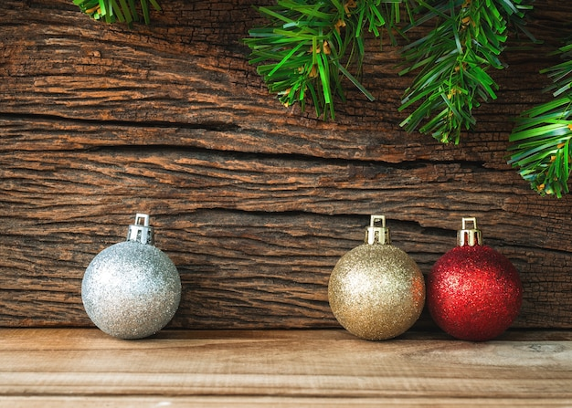 Christmas decoration on wooden background, christmas ball gold, silver and red.