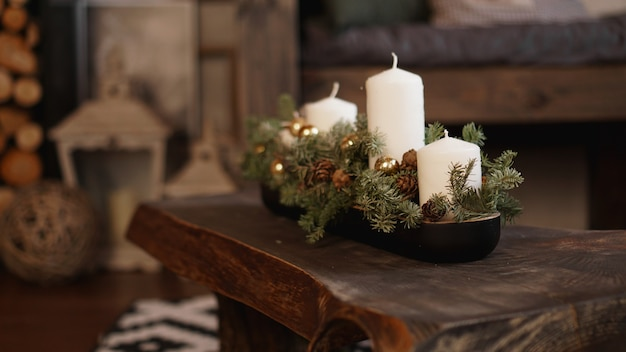 Christmas decoration on wooden table. christmas white candles on a wooden table