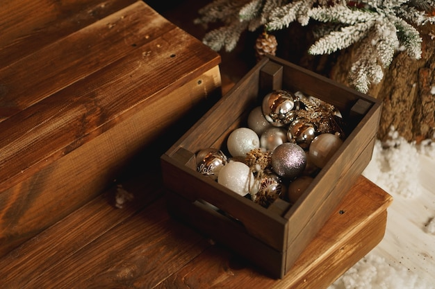 Christmas decorations in a box on a wooden table