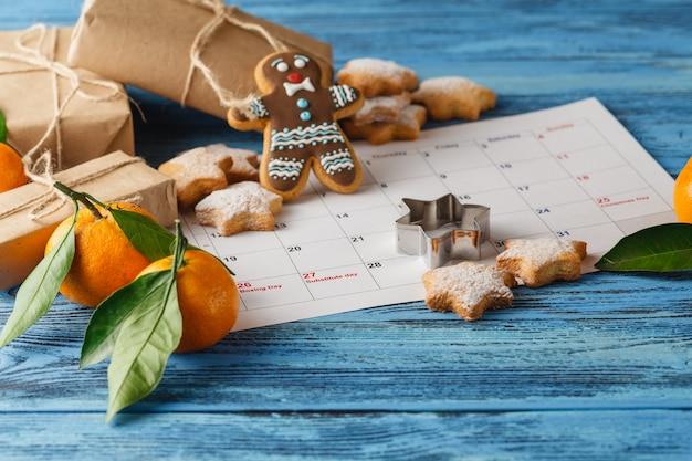 Christmas decorations over calendar, december month