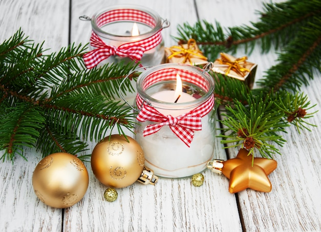 Christmas decorations candles in glass jars with fir