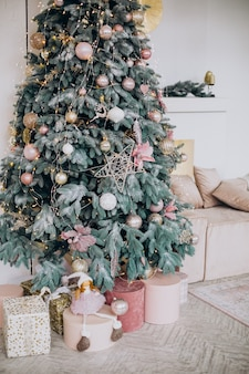 Christmas decorations and christmas tree in room