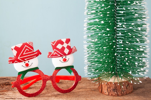 Christmas decorations and christmas tree on wooden table