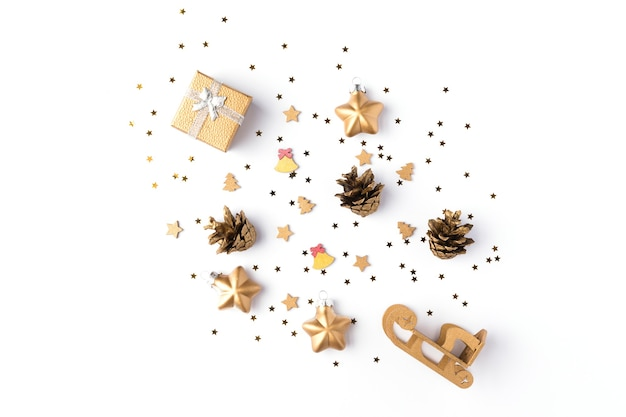 Christmas decorations collection with gold stars, pine cones and gift for mock up isolated on white background. top view. flat lay