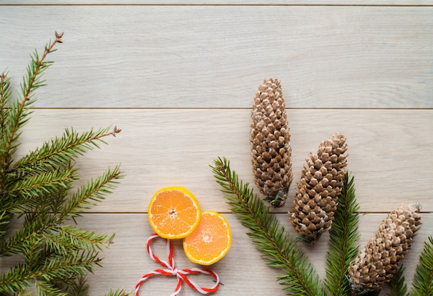 Christmas decorations from fir-tree branches and the fruits of mandarin orange