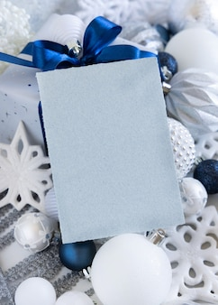 Christmas decorations and gift box with blank card close up