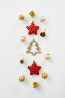 Christmas decorations in gold and red on white