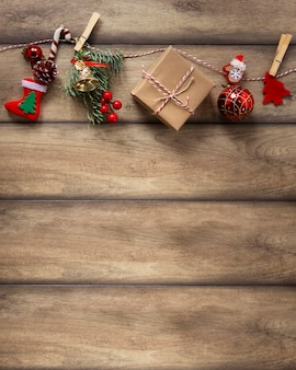 Christmas decorations hanging on wooden background