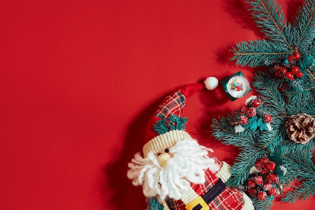 Christmas decorations on hot red background. christmas and new year theme. place for your text, wishes, logo. mock up. top view. copy space. still life. flat lay.