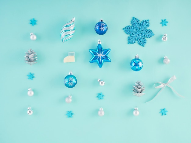 Christmas decorations on light blue surface