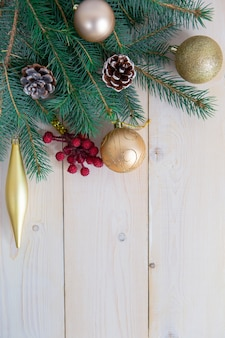 Christmas decorations on a light wooden surface with space for text.