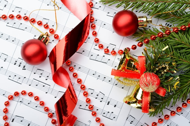 Christmas decorations lying on notes sheet