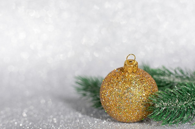 Christmas decorations made of gold and silver balls with blurred glitter background, copy space