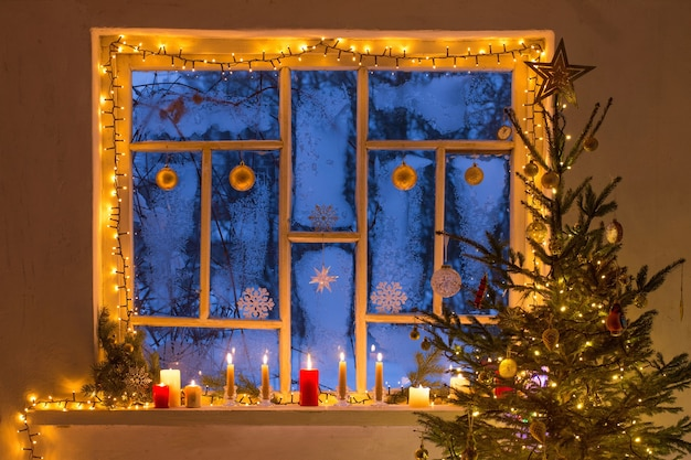 Christmas decorations on old wooden window
