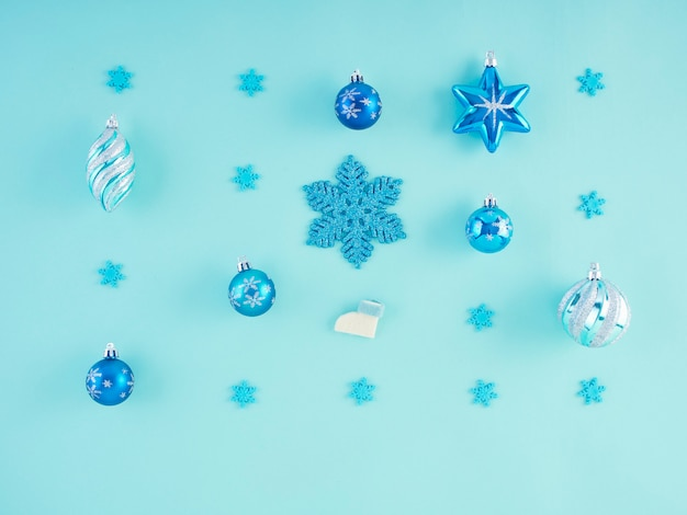 Christmas decorations on pastel blue surface