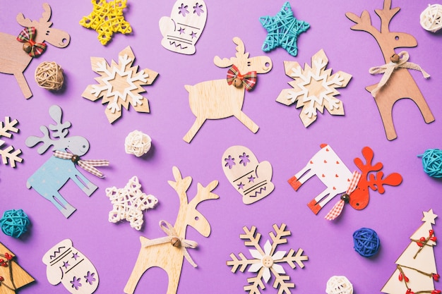 Christmas decorations on purple table