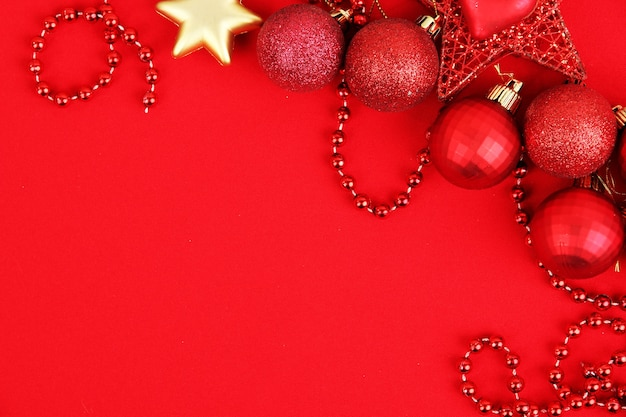 Christmas decorations on red surface