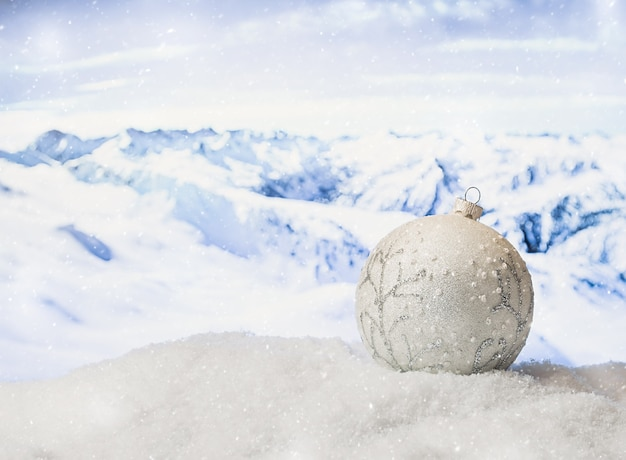 Christmas decorations in a snowdrift in front of snowy mountains winter christmas surface