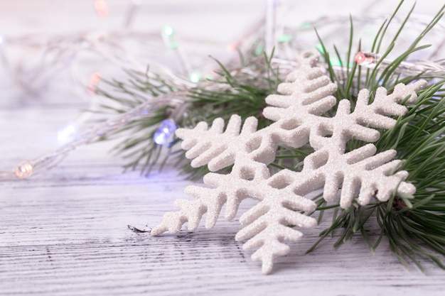 Christmas decorations: snowflake pine branch garland close-up