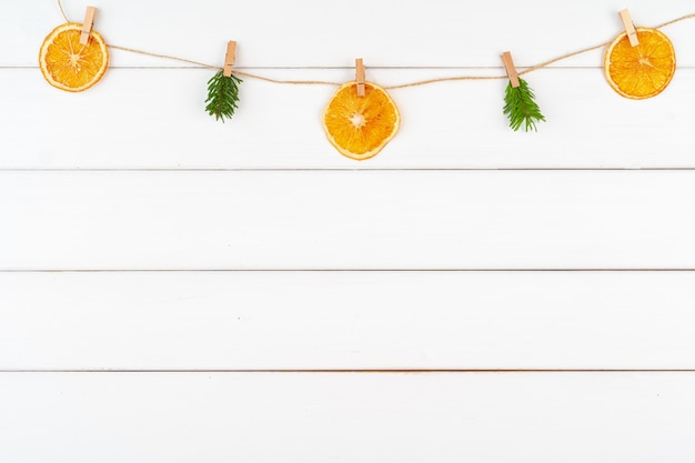 Christmas decorations on white wooden background with copy space