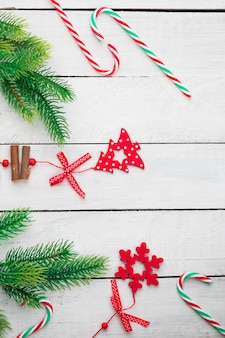 Christmas decorations on white wooden desk. flat lay space for text.