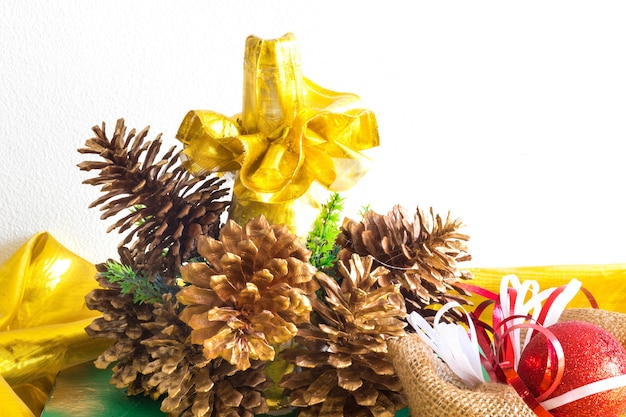 Christmas decorations with candles, pine and ribbons