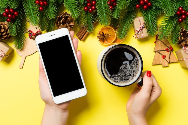 Christmas decorations with empty screen smartphone