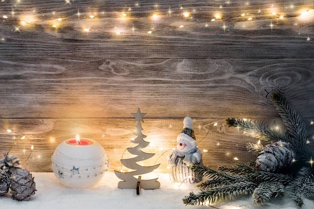 Christmas decorations with light garland and spruce