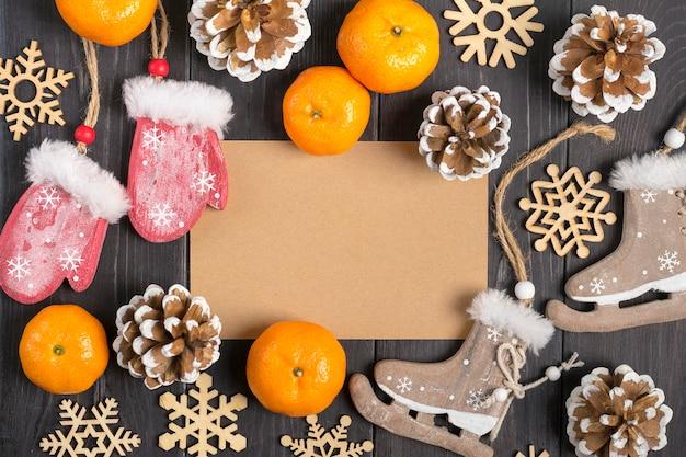 Christmas decorations - wooden deer, gloves, skates, snowflakes, cones, tangerines