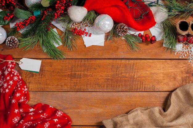 Christmas decorations on wooden table background with copyspace