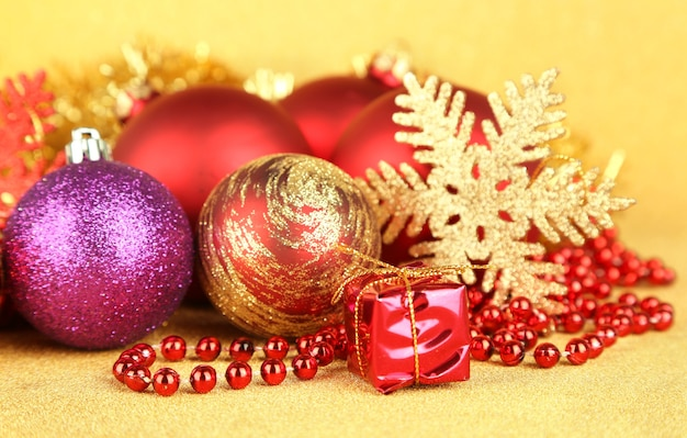 Christmas decorations on yellow background