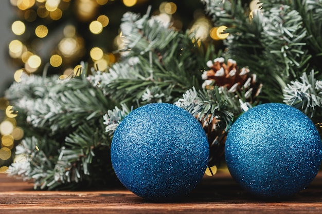 Christmas decorative balls against blurred pine tree background