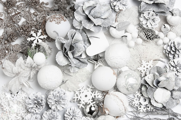 Christmas decorative composition of toys on a white wall surrealism. top view