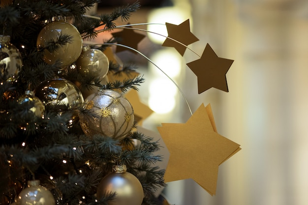 Christmas decorative composition with golden stars on a christmas tree