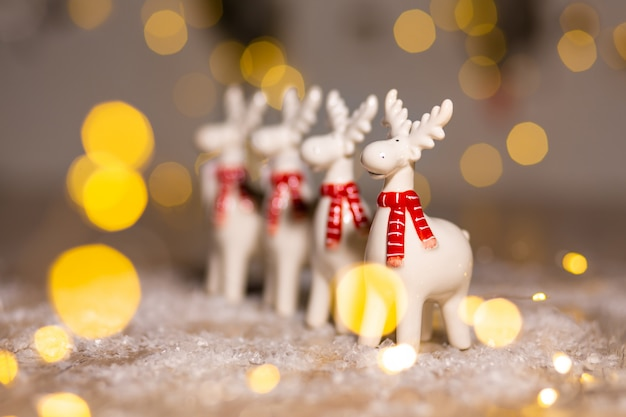 Christmas deer festive decor, warm bokeh lights.