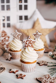 Christmas delicious cupcakes decorated with a gingerbread star.